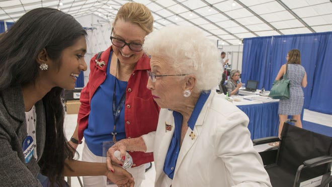 Jerry Emmett, 102-year-old honorary chair of the Arizona Democratic delegation, talks to Sruthi Palaniappan, 18-year-old Iowa delegate at Democratic National Convention in Philadelphia on July 27.