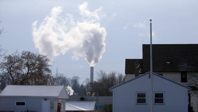 Emissions pour from a stack near neighboring homes at Mid-America Steel Drum at 3950 S. Pennsylvania Ave. in St. Francis.