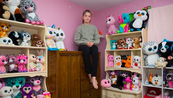 Cindy Redmond poses for a portrait in her bedroom in Talleyville, Del. Redmond was diagnosed with hyperacusis, a condition where normal environmental sound is intolerable and loud noises can be extremely painful.