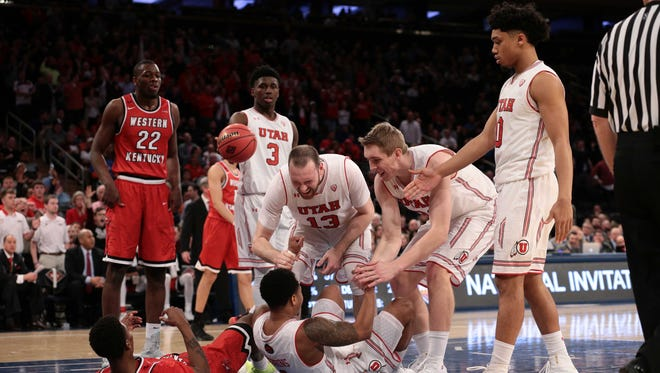 Utah Utes guard Justin Bibbins (1) reacts with forwards Donnie Tillman (3), David Collette (13), Tyler Rawson and guard Sedrick Barefield (0) against the Western Kentucky Hilltoppers.