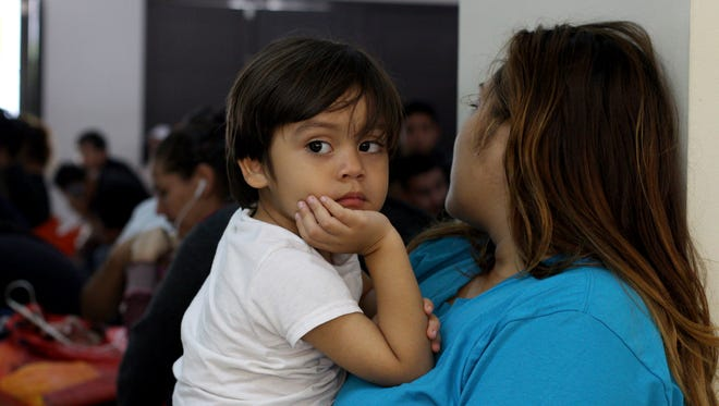 Katty Rodriguez and her 3-year-old son, Jose Luis, who were recently deported from the U.S. wait for their turn in La Chacra Immigration Center, in San Salvador, El Salvador. Rodriguez was kept apart from her son for 4 months, in McAllen, Texas, and was reunited with him only on they day when they were flown back to El Salvador.