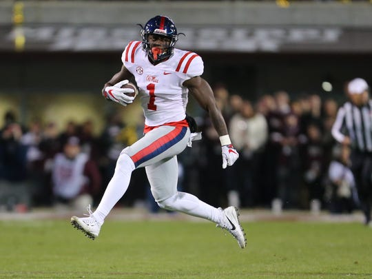 Ole Miss's A.J. Brown (1) runs free of defenders in the first quarter Thursday in Starkville.