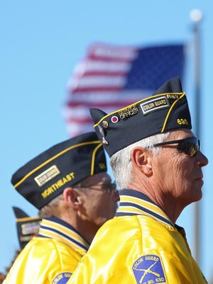 Members of the American Legion Northeast Post 630 stand at attention on Veterans Day.