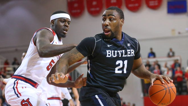 Butler Bulldogs forward Roosevelt Jones (21) drives around St. John's Red Storm forward Durand Johnson (5) during the first half at Carnesecca Arena.