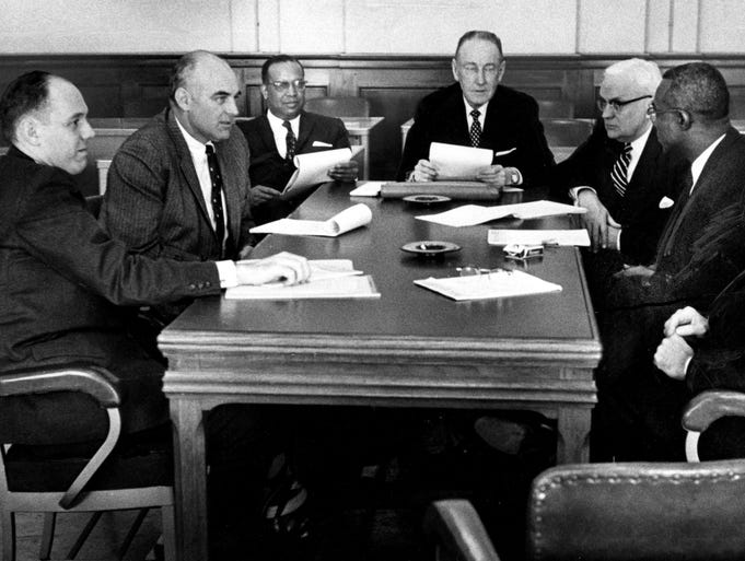 Nashville Mayor Ben West's special committee on sit-in demonstrations confers just before the start of its first meeting in city council chambers on March 5, 1960. In attendance are George Barrett, left; F. Donald Hart; Dr. W.S. Davis; Madison Sarratt, committee chairman; Lipscomb Davis; Dr. Stephen Wright, committee secretary; and B.B. Gullett.