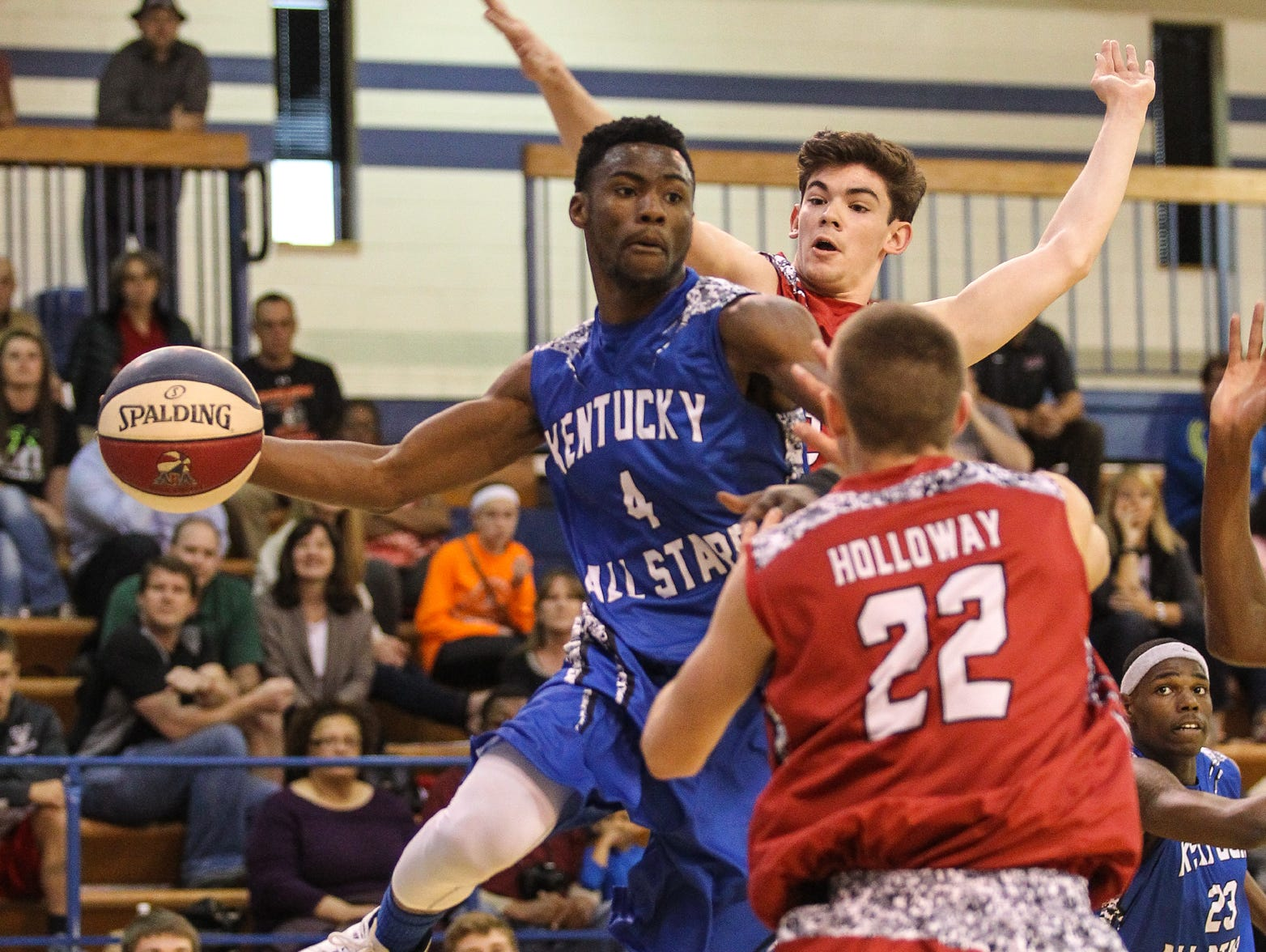 Kentucky's Terrell Grey looks to pass the ball near the basket during the Ohio-Kentucky All-Star game, Saturday, April 11, 2015.