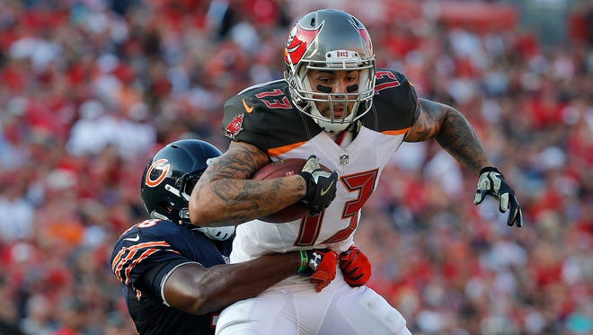 Tampa Bay Buccaneers wide receiver Mike Evans (13) runs with the ball as Chicago Bears free safety Adrian Amos (38) defends during the second half at Raymond James Stadium.