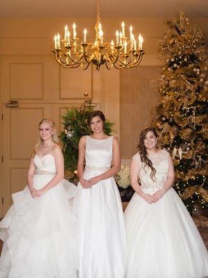 The Carillon and Clavier dance clubs present Margaret Hood (from left) , Katherine McClellan and Lauren Meaders during their annual Christmas Debutante Presentation.