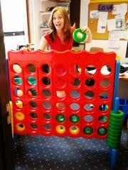 Cass Duffey tests out the giant Connect Four game that will be at Collingswood's Get Up! event Tuesday.