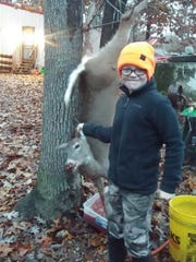 Gabe Simpson 10, Buffalo, with his first deer he shot during the recent deer season.