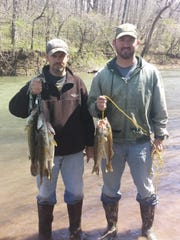 Brad Hailey, left, and Gabe Gray, with stringers full