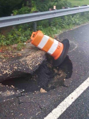A sinkhole caused by a rainstorm on county Route 553 in Lawrence Township that was repaired.