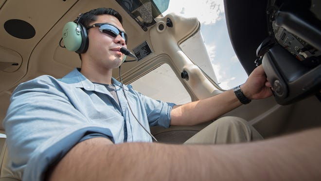 Cadet James Huang, North Gwinnett High School, Suwanee, Georgia, sits in the cockpit of a trainer aircraft at Auburn University, Alabama. Huang is one of 120 cadets selected for a Flight Academy scholarship by Air Force Junior ROTC.