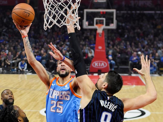 Los Angeles Clippers guard Austin Rivers shoots as Orlando Magic guard Jamel Artis defends during the first half of an NBA basketball game Saturday, March 10, 2018, in Los Angeles. (AP Photo/Mark J. Terrill)