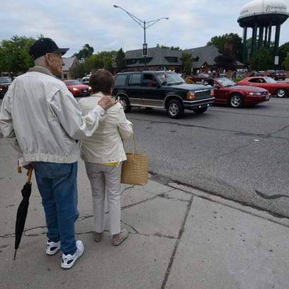 Cal and Phyllis Blum of White Lake stand along Woodward