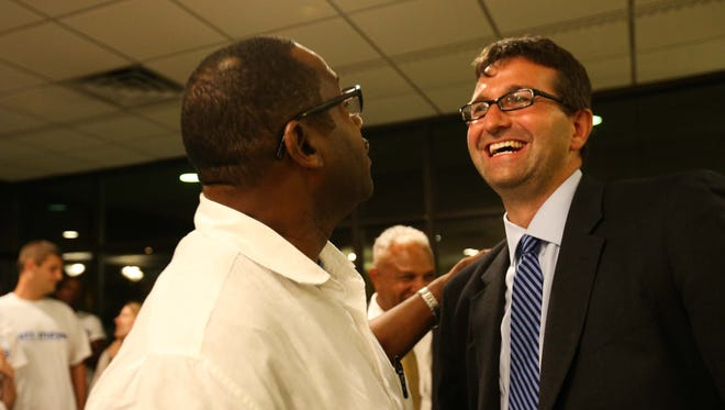 New Castle County Executive democratic nominee Matt Meyer, right, is congratulated by Stan Salaam, of Wilmington, during a primary election watch party at Park Plaza in Wilmington Tuesday.