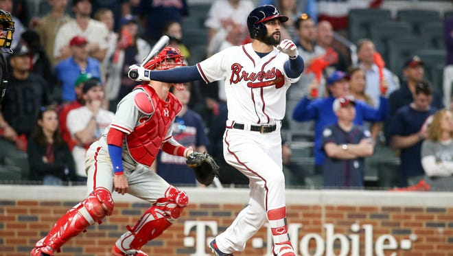 Atlanta Braves right fielder Nick Markakis (22) hits a walk-off three-run home run against the Philadelphia Phillies in the ninth inning at SunTrust Park on Thursday, March 29, 2018, in Atlanta.