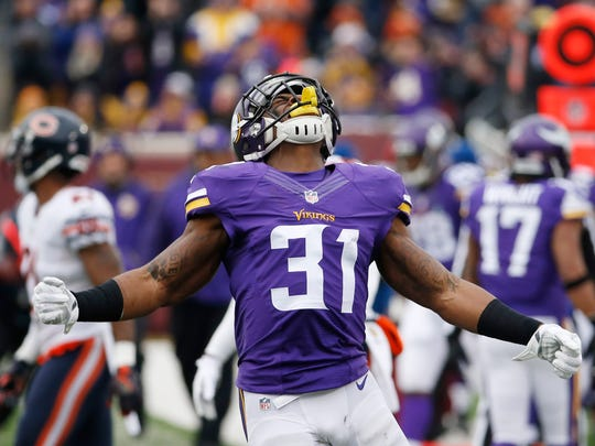 Minnesota Vikings running back Jerick McKinnon (31) reacts after a long run during the first half of an NFL football game against the Chicago Bears, Sunday, Dec. 20, 2015, in Minneapolis. (AP Photo/Ann Heisenfelt)