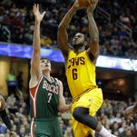 Cleveland Cavaliers' Earl Clark (6) goes up for a shot against Milwaukee Bucks' Ersan Ilyasova (7), from Turkey, in an NBA basketball game Friday, Jan. 24, 2014, in Cleveland. (AP Photo/Mark Duncan)