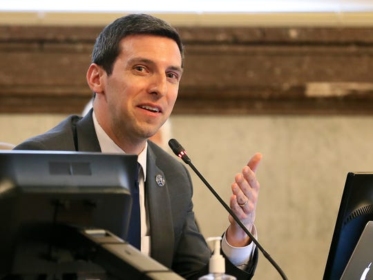 Cincinnati City Councilman P.G. Sittenfeld and other members of Cincinnati City Council discuss city business and a severance package for City Manager Harry Black on Wednesday.