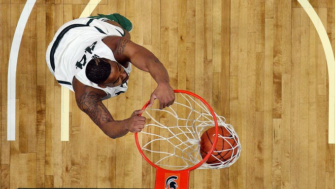 Michigan State forward Nick Ward (44) dunks against Iowa on Feb. 11, 2017.