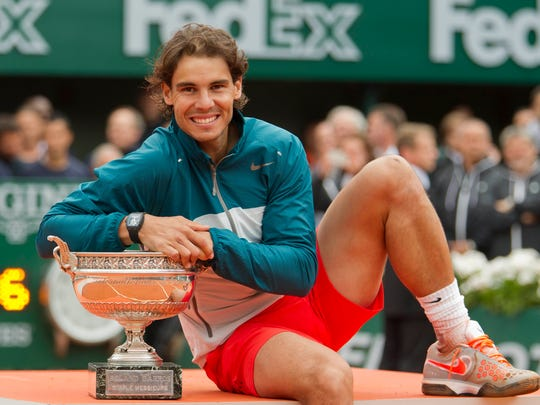 Rafael Nadal (ESP) poses with the championship trophy