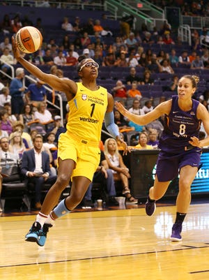 Chicago Sky guard Diamond DeShields drives to the basket past Phoenix Mercury forward Stephanie Talbot in the first half on July 25, 2018 at Talking Stick Resort Arena in Phoenix, Ariz.