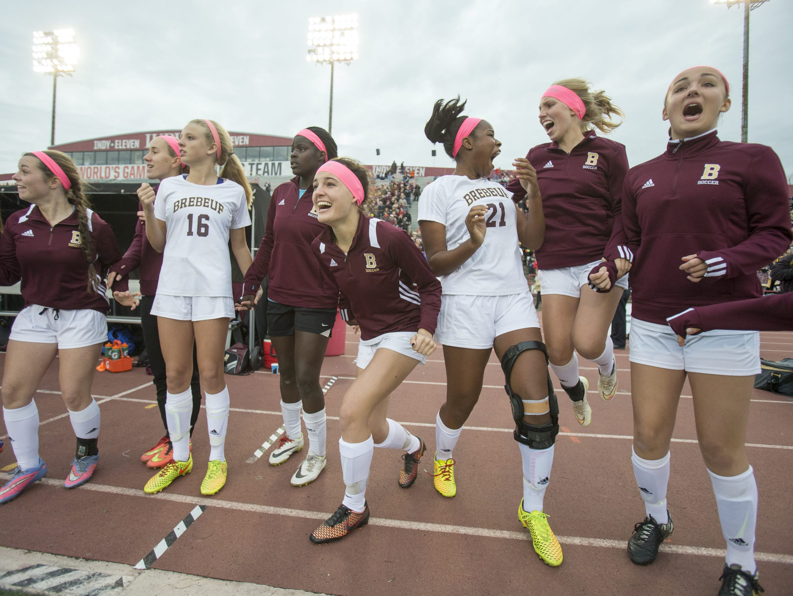 FILE – Brebeuf Jesuit players yell and jump as they count down the final seconds of the Class 2A State Soccer Finals at Michael A. Carroll Stadium, Oct. 31, 2015.