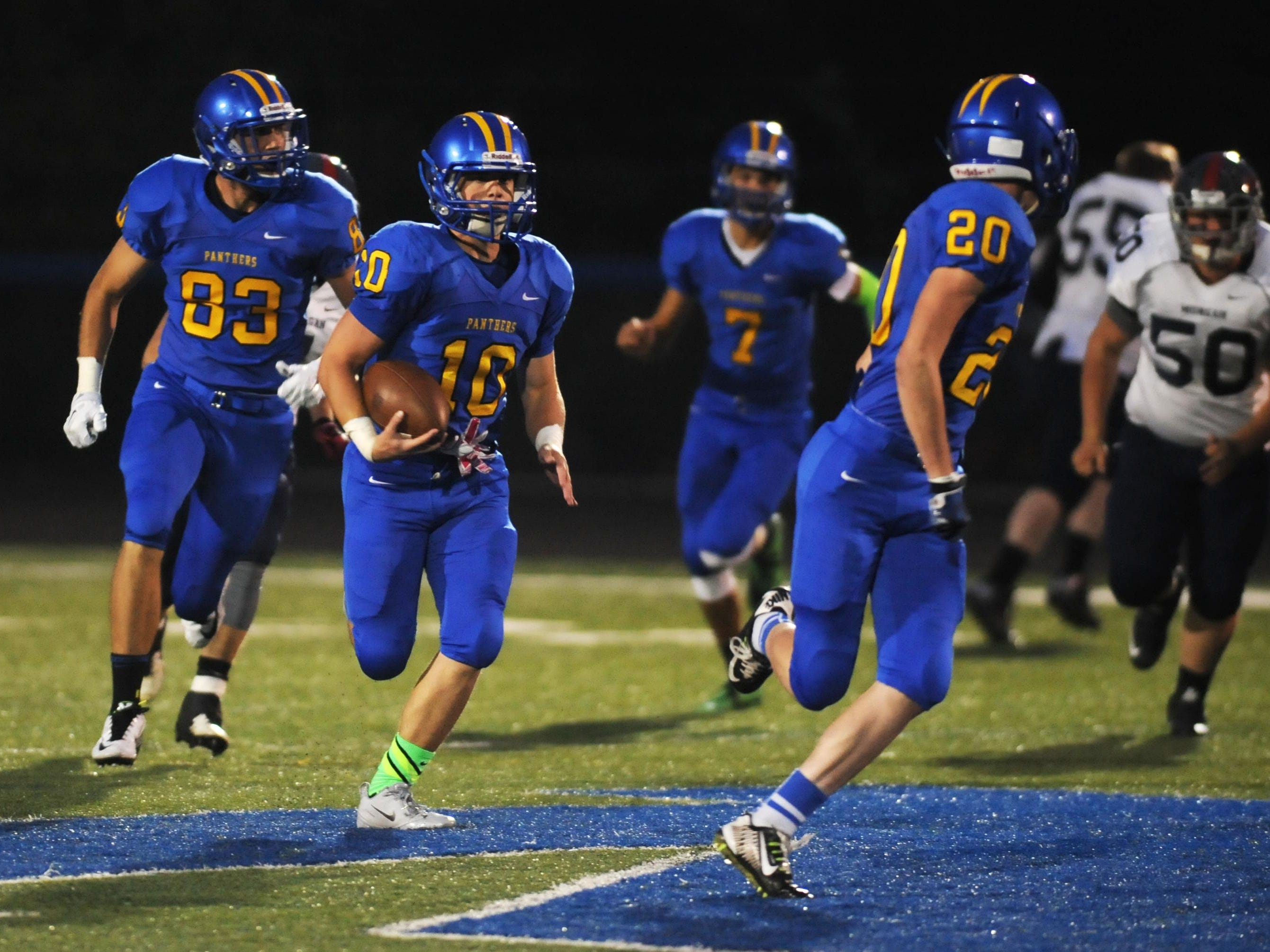 Maysville's Evan Brown carries the ball after a fake punt in the first quarter against Morgan on Friday. The play set up the Panther's first touchdown, and they went on to win 56-7.