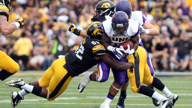 Northern Iowa running back Evan Williams (8) is tackled by Iowa linebacker Quinton Alston at Kinnick Stadium. Iowa beat Northern Iowa 31-23.  Mandatory Credit: Reese Strickland-USA TODAY Sports