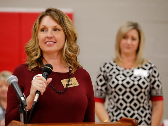CCEA president Lisa Poor speaks at the Northern Kentucky Rally for Public Pensions at Dixie Heights High School in Edgewood, on Tuesday, Oct. 24, 2017. Hundreds of public school teachers and supporters gathered in the school gym to protest proposed plans to change public pensions.