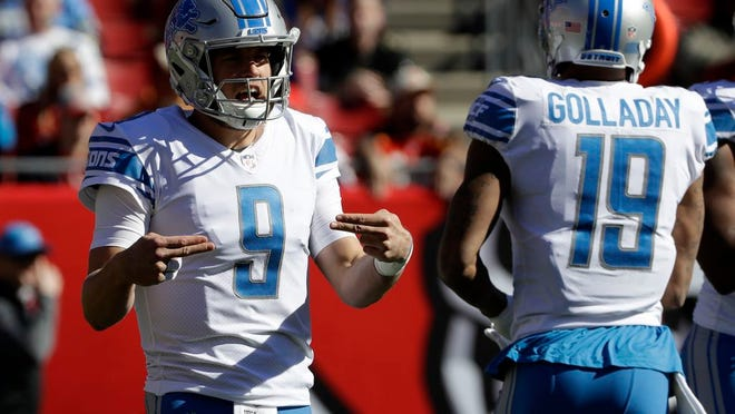 Detroit Lions quarterback Matthew Stafford (9) calls a play with wide receiver Kenny Golladay (19) during the first half of an NFL football game against the Tampa Bay Buccaneers Sunday, Dec. 10, 2017, in Tampa, Fla.