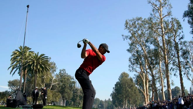 Tiger Woods tees off on the 12th hole during the final round of the Genesis Invitational golf tournament at Riviera Country Club, Sunday, Feb. 16, 2020, in the Pacific Palisades area of Los Angeles.