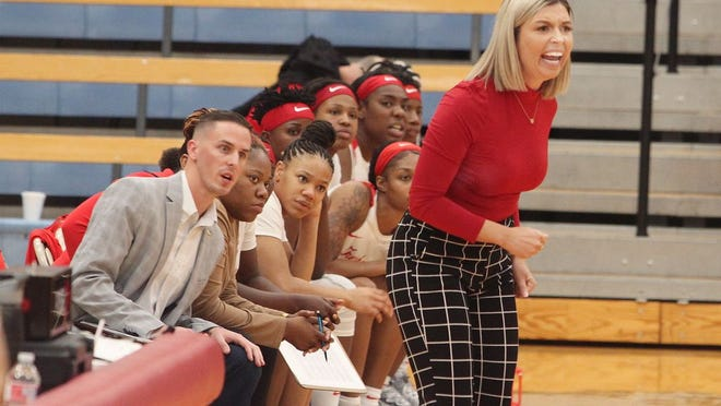 Moberly Area Community College women's head basketball coach Hana Haden stands before her team bench as she gives instructions at a home game played at the Fitzsimmons-John Arena during the 2019-2020 season.