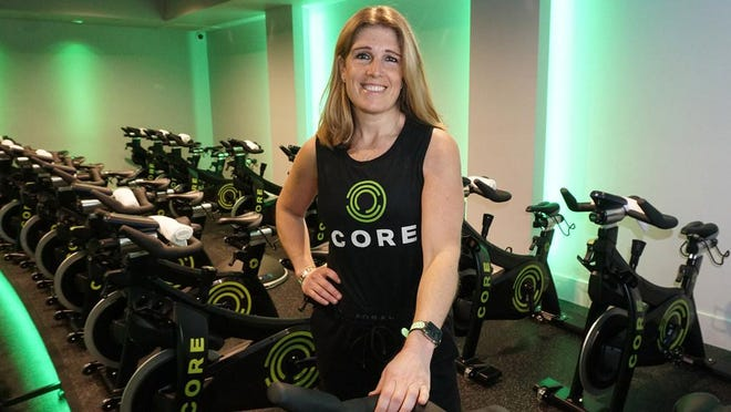 Gyms, such as CORE fitness studio in Providence, shown here with owner Denise Chakoian, are among the businesses closed by the coronavirus pandemic that will be allowed to reopen Monday.