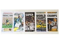 Front page reproductions of the Green Bay Press-Gazette's coverage of the Packers.