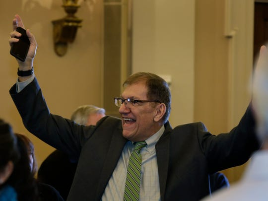Hank Fuhs, of Grand Rapids, and Secretary of the Michigan Republican Committee, holds his hands up in jubilation as he announces that it was made official that Ronna Romney McDaniel was named RNC Chair during the Michigan Pre-Inaugural Open House Thursday Jan. 19, 2017 in the Longworth House Office Building in Washington D.C. Mandi Wright/Detroit Free Press