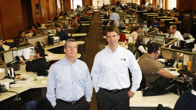 """Total Quality Logistics is """"always in growth-mode,"""" says Executive Vice President Kerry Byrne, left, with company founder Ken Oaks."""