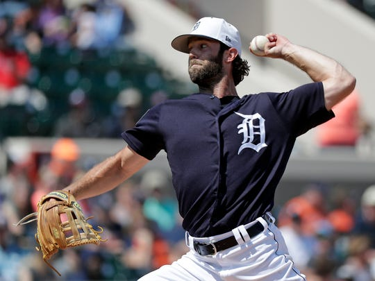 Detroit Tigers pitcher Daniel Norris throws against the Atlanta Braves in the fourth inning Sunday.