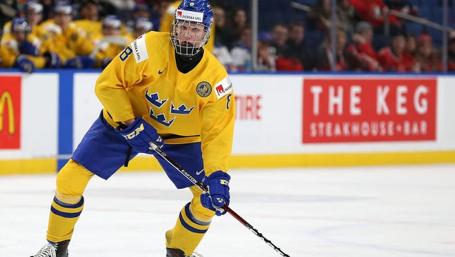 Rasmus Dahlin of Sweden plays the puck during the IIHF World Junior Championship against the United States at KeyBank Center in Buffalo on Jan. 4. The Buffalo Sabres won the NHL draft lottery on Saturday and could be the first overall selection.