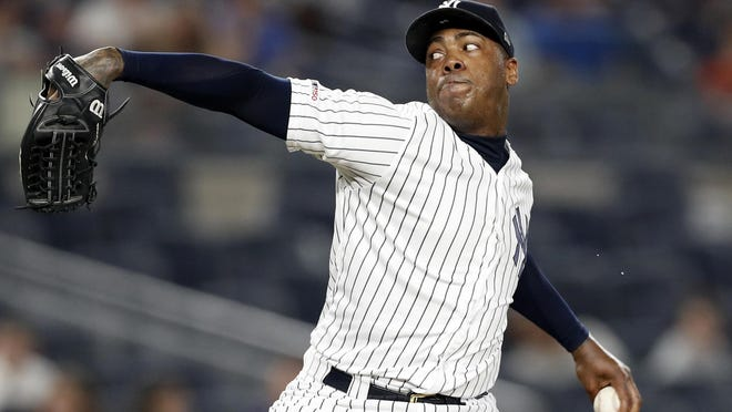 New York Yankees closer Aroldis Chapman winds up in the ninth inning of a June 24, 2019, game against the Toronto Blue Jays in New York. Yankees manager Aaron Boone announced Saturday that Chapman has tested positive for the coronavirus and is experiencing mild symptoms.