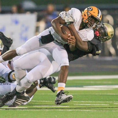 T.L. Hanna's  Zacch Pickens tackles Greenwood's Isaiah
