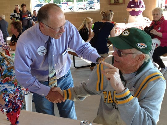 Joe Majeski, running for the 1st Assembly District seat now held by state Rep. Garey Bies, shakes hands at a Door County Democratic picnic at Sawyer Park in Sturgeon Bay Thursday.