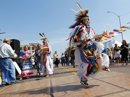 Micah rider Young Bear, 11, performs the Mesqwaki Pipe Dance during the 2014 World Food & Music Festival in downtown Des Moines.