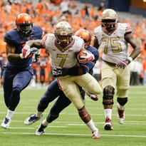 Florida State running back Mario Pender (7) breaks a tackle by Syracuse's Marqez Hodge as he rushes for a touchdown during the first half of an NCAA college football game Saturday, Oct. 11, 2014, in Syracuse, N.Y. (AP Photo/Frank Franklin II)