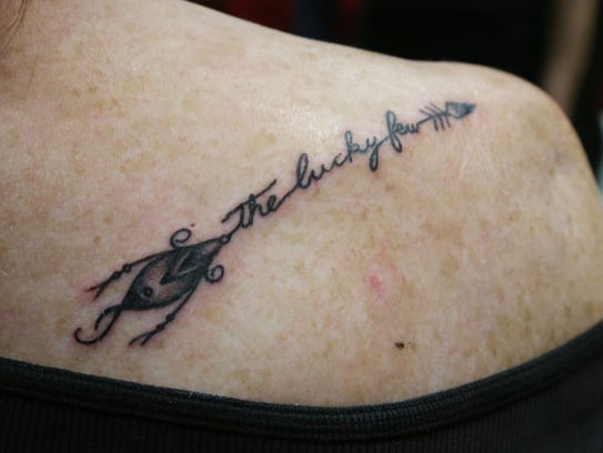 Diedre Chaffee of Poughquag shows off her new tattoo