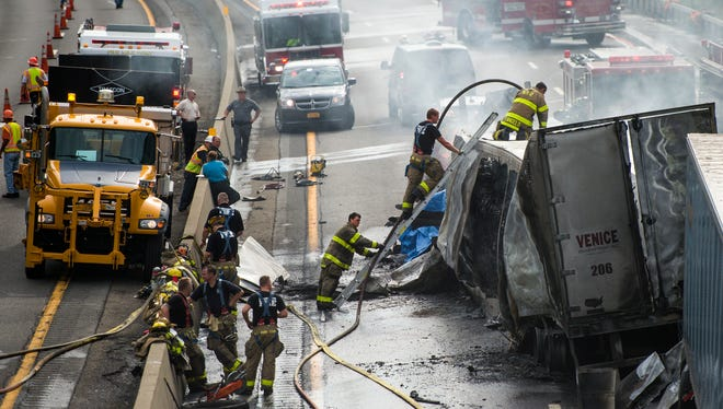 Firefighters work the scene of a fatal triple tractor-trailer crash Wednesday morning on Interstate 81 south near Exit 3 at Broad Avenue.