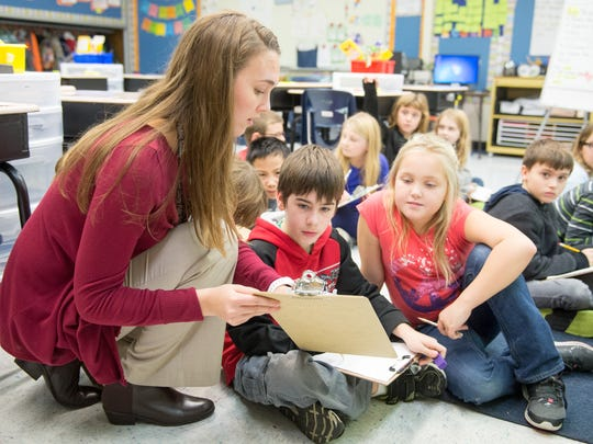 Showell Elementary School third grade teacher Liz Davidson holds a science lesson based on senses and using graphs for data during class on Thursday, December 17th in Berlin.