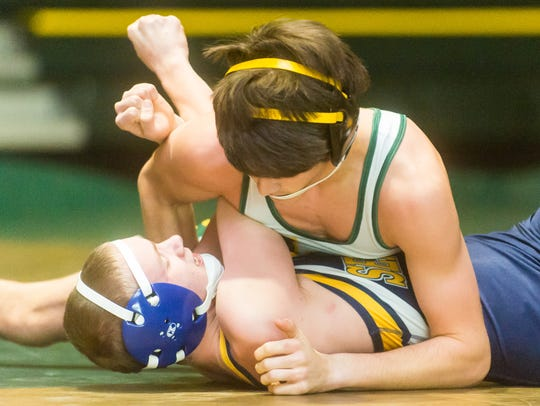 Indian River's Mitchell Bolton (113-lb) squares off