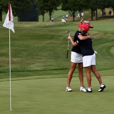 Team USA's Lexi Thompson embraces Cristie Kerr, right, following their victory Saturday.